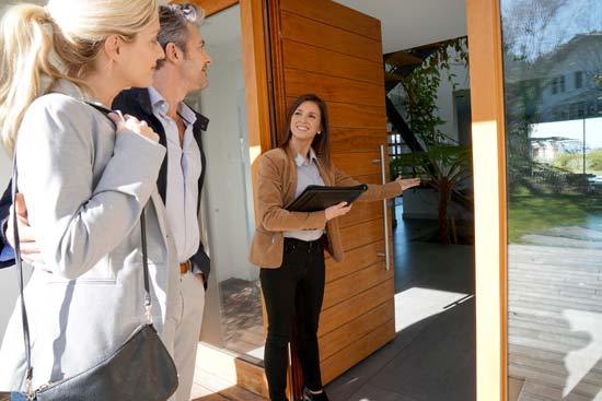 Real estate agent showing a showing in Hawaii - Culley Insurance Group